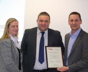 Adrian Taylor of Eric Wright (centre) picks up the licence from Network Rail